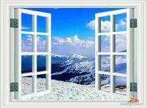 Open raam met uitzicht op berg met sneeuw en blauw lucht. Full color muursticker