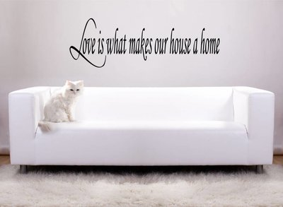 Love is what makes our house a home. Muursticker / Interieursticker